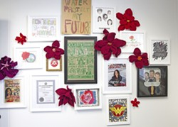 ROSES EVERYWHERE The office of SLO Mayor Heidi Harmon is filled with rose-inspired artwork, many made and gifted by friends. - PHOTO BY JAYSON MELLOM
