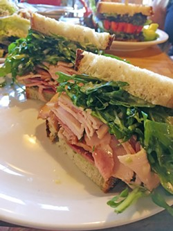YUM! Smoked turkey, arugula, basil mayo, and deliciously seasoned olive oil make up this sandwich from Industrial Eats in Buellton, and I'm still dreaming about it four days later. - PHOTO BY CAMILLIA LANHAM