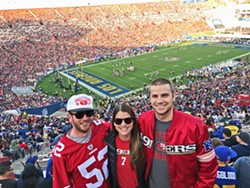 FAMILY TIME My sister, her boyfriend, and I soak in a San Francisco 49ers win against the Los Angeles Rams on New Year's Eve. - PHOTO COURTESY OF PETER JOHNSON
