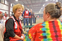 LENDING AN EAR Longtime Red Cross volunteer Carolyn Pandol listens to shelter resident Michelle Mullin tell the story of how she escaped from the Thomas Fire. - PHOTO BY DERMOT TATLOW COURTESY OF THE RED CROSS