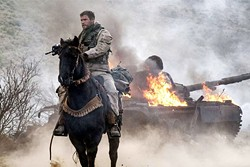 ALL IN In the aftermath of 9/11, Capt. Mitch Nelson (Chris Hemsworth) leads a U.S. Special Forces team into Afghanistan on a dangerous mission in 12 Strong. - PHOTO COURTESY OF WARNER BROS. PICTURES