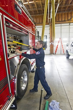 RESPONSIBILITIES Jeff Lane, a reserve firefighter for the Five Cities Fire Authority, must not only respond to emergencies but he is also responsible for the fire truck. - PHOTO BY JAYSON MELLOM