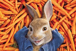 SILLY RABBIT Tensions build between Peter (voiced by James Corden) and Mr. McGregor (Domhnall Gleeson) as they rival for the affections of Bea (Rose Byrne) in Peter Rabbit. - PHOTO COURTESY OF COLUMBIA PICTURES