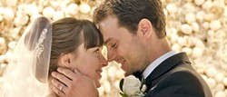 HAPPILY EVER AFTER? In Fifty Shades Freed, newly weds Christian (Jamie Dornan) and Ana (Dakota Johnson) try and adjust to their new life while dealing with threats to their happiness. - PHOTO COURTESY OF UNIVERSAL PICTURES