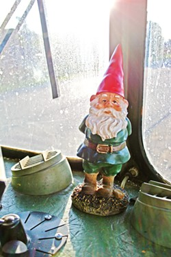 """PROTECTOR OF GREENS Garden gnomes keep a watchful eye on SLO County's first ever """"mobile micro farm."""" - PHOTO BY HAYLEY THOMAS CAIN"""