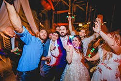 UNIQUE The recent wedding of Naseem and Alex stands out to photographer Blake Andrews for many reasons including that everyone used glow sticks while dancing at night. - PHOTO COURTESY OF BLAKE ANDREWS