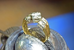 RE-CREATED In order to make something new for a client who came in wanting to combine several family rings, local jewelers and husband-and-wife team David Hillebrecht and Amanda Stephens first had to tear things apart. - PHOTO COURTESY OF GARDEN STREET GOLDSMITHS