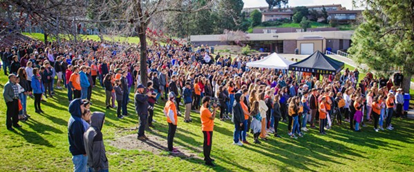 ENOUGH Students gathered on the lawn at San Luis Obispo High School during the March 14 student walkout to protest gun violence on school campuses and honor the 17 victims who were shot in Parkland, Florida, on Feb. 14. - PHOTO BY JAYSON MELLOM