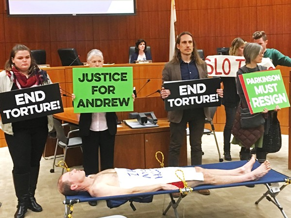 PUBLIC OUTCRY The release of video footage of Andrew Holland's death in SLO County Jail resulted in two very public protests, one of which shut down a SLO County Board of Supervisors meeting. - PHOTO BY PETER JOHNSON