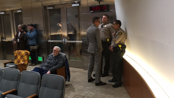 Horton confers with sheriff's deputies as the protest ensued.