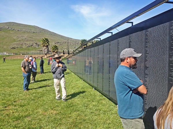 THE WALL THAT HEALS A three-quarter-scale traveling replica of the Vietnam Veterans memorial was constructed in Madonna Meadows from March 29 through April 1. - PHOTO BY CHRIS MCGUINNESS