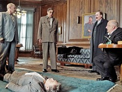 CALL A DOCTOR? After Stalin (Adrian McLoughlin, lying down) falls gravely ill, each member of his power mad inner circle (left to right: Steve Buscemi, Jeffery Tambor, Dermot Crowley, and Simon Russell Beale) plots his next move. - PHOTO COURTESY OF MOVIEWEB.COM