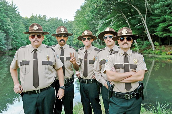 IDIOTS Vermont Troopers—(left to right) Rodney Farva (Kevin Heffernan), Arcot 'Thorny' Ramathorn (Jay Chandrasekhar), Robert 'Rabbit' Roto (Erik Stolhanske), Carl Foster (Paul Soter), MacIntyre 'Mac' Womack (Steve Lemme)—open an office in a disputed border town between Canada and the U.S. - PHOTO COURTESY OF BROKEN LIZARD INDUSTRIES