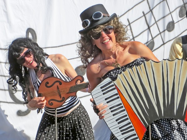 BE A GOOF Liz Rhoads Cordoba and Marianne Orme have fun with the backstage green room props ... because everyone's a kid at the Live Oak Music Festival. - PHOTO COURTESY OF MARIANNE ORME AND LIZ RHOADS CORDOBA
