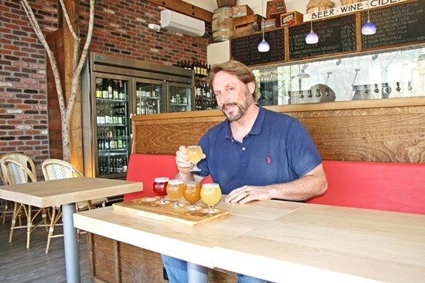 """WHERE THE WILD THINGS BAR Cider Bar Owner Kevin Mclaughlin (right) aimed to create a """"country French café feel"""" at his new haunt, located within the SLO Creamery. Here, you can sip from dozens of apple ciders, fruit ciders, beer, and wine options accompanied by small plates like braised short ribs, spicy pickled carrots, and charcuterie imported from Spain and France. - PHOTO BY HAYLEY THOMAS CAIN"""