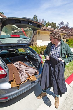 MOVING DAY Actor Toby Tropper loads his car up with all his worldly possessions in preparation for driving to Utah for an acting gig this summer. - PHOTO BY JAYSON MELLOM