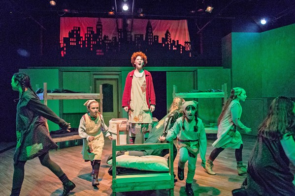 HARD KNOCK LIFE Annie (Liana Lindsey, center) is a girl with a note and half a locket from her birth parents, hoping they'll rescue her from a miserable life at an orphanage. - PHOTO COURTESY OF RYLO MEDIA DESIGN