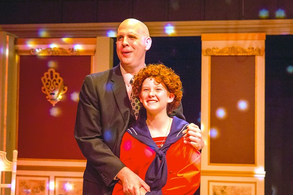 SOMETHING WAS MISSING After spending the holidays together, bachelor and millionaire Oliver Warbucks (Ben Abbot) starts to feel paternal toward Annie (Liana Lindsey). - PHOTO COURTESY OF RYLO MEDIA DESIGN