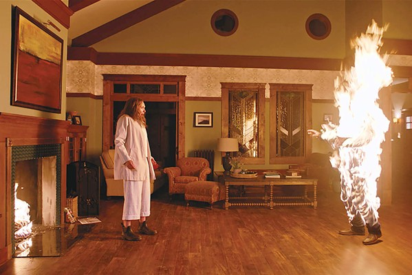 DEVIL'S DEBT Annie (Toni Collette) watches in horror as her loved one spontaneously bursts into flames. - PHOTO COURTESY OF A24 AND PALMSTAR MEDIA