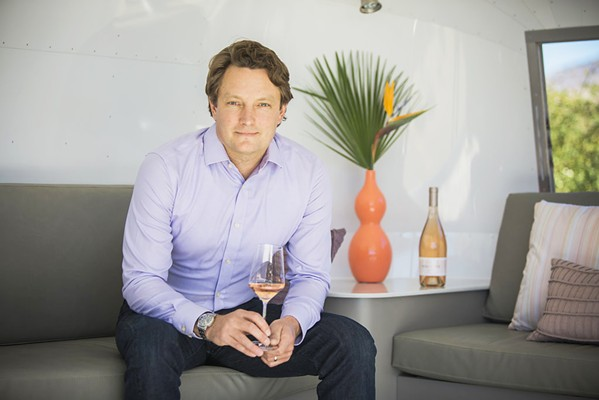 "MAN IN PINK Chamisal Vineyards and Malene Wines Winemaker and General Manager Winemaker Fintan ""Fin"" du Fresne has thrown a modern, Californian twist on the classic rosés of Provence, France. He is also the owner of the new business Winery Mechanical Systems, which aims to service SLO County's wine industry with mechanical repairs and maintenance. - PHOTO COURTESY OF MALENE"