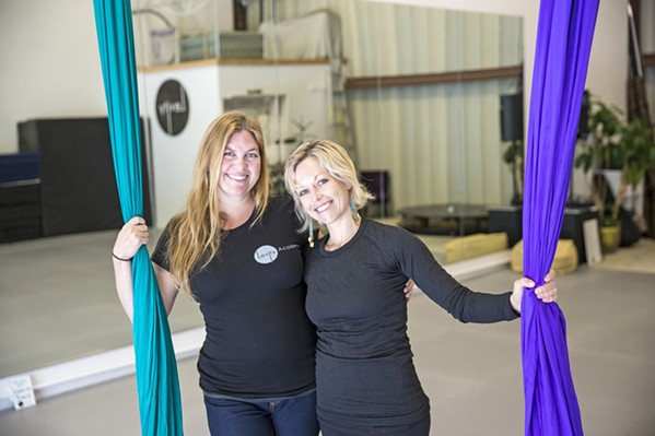 SOMETHING NEW In April, Gigi Penton (left) and Lei Lei de Kirby (right), friends and new co-owners, began to transition Suspended Motion Aerial Arts to the new Levity Academy in a space on Suburban Road in SLO. - PHOTO BY JAYSON MELLON