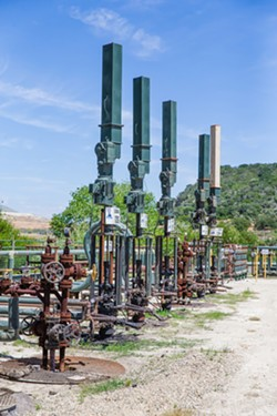 TECHNOLOGICAL ADVANCE Linear rod pumps like these are dispersed among old style pump-jacks on the Arroyo Grande oil field. - PHOTO BY JAYSON MELLOM