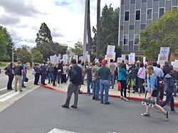 JANUS IMPACT Members of Cal Poly's faculty union march on campus in 2016. A recent decision by the U.S. Supreme Court will ban public sector unions like this one from collecting fees from nonmembers. - FILE PHOTO BY CHRIS MCGUINNESS