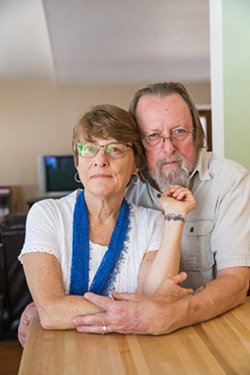 PAYING TRIBUTE Kim Lacey, of Atascadero, with her husband, Dan Grahm, in their home, shows her tattoo that she got in memory of her son Ty after he overdosed on heroin in 2016. - PHOTO BY JAYSON MELLOM