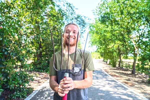 MAKING THE CONNECTION Combining his love for both agriculture and technology, Cam Sluggett created an app that connects farmers and consumers. - PHOTO COURTESY OF ARKITU