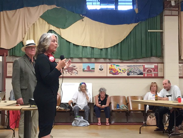 WILL THE REAL PROGRESSIVE PLEASE STAND UP? SLO Mayor Heidi Harmon (right) addresses the SLO County Progressives Democratic Club on July 26, as her election challenger, T. Keith Gurnee (left), watches. The club overwhelmingly endorsed Harmon for mayor, but not before Harmon cut the forum short. - PHOTO BY PETER JOHNSON
