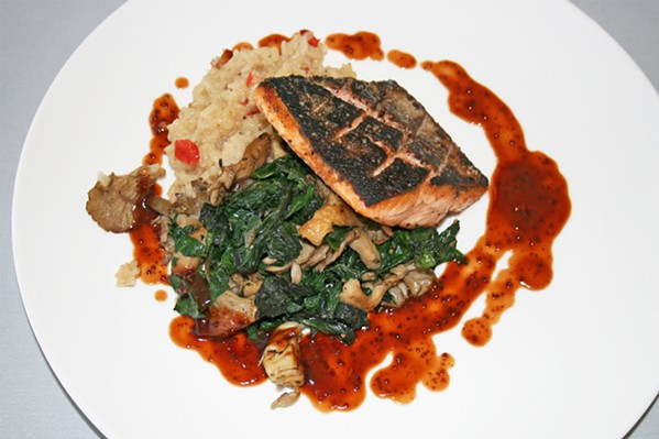 LABOR OF LOVE A portion of wild mushroom rainbow chard offers a tender, earthy bite in contrast with flavorful seared Pacific salmon topped with syrah barbecue sauce. - PHOTO BY HAYLEY THOMAS CAIN