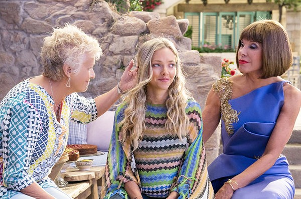 HOW CAN I RESIST YOU? In Mama Mia! Here We Go Again, Sophie (Amanda Seyfried, center) finds out more about her mother's past, while she is pregnant herself. - PHOTO COURTESY OF UNIVERSAL PICTURES