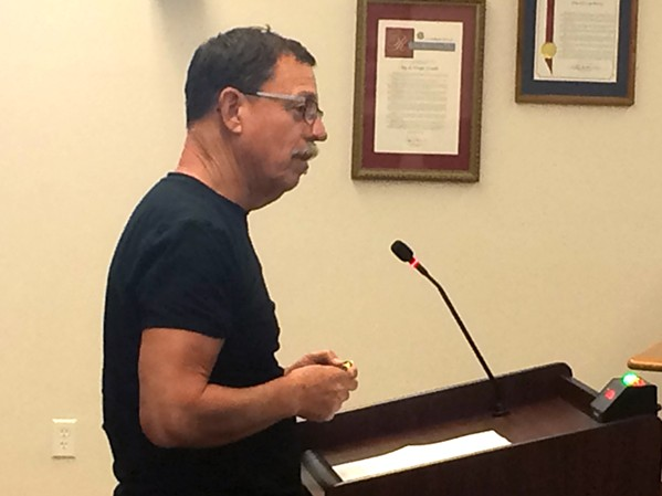 MAKING A CASE Arroyo Grande is moving forward with plans to disband three citizen advisory commissions. Arroyo Grande Historical Commission Chairman Bill Hart (above) argued against the decision at an Aug. 14 meeting. - PHOTO BY CHRIS MCGUINNESS