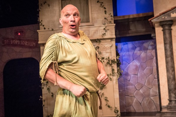 FREE! The crafty Pseudolous (Billy Breed) tries to win his freedom by helping his master get the girl of his dreams in SLO Rep's production of A Funny Thing Happened on the Way to the Forum. - PHOTO COURTESY OF RYLO MEDIA DESIGN