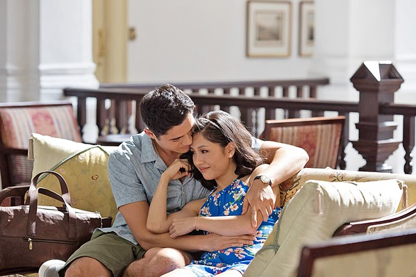 LOVE AND MONEY New York economics professor Rachel Chu (Constance Wu, right) travels to Singapore to meet her boyfriend, Nick Young's (Henry Golding), ridiculously wealthy family, in Crazy Rich Asians, based on Kevin Kwan's best selling novel. - PHOTO COURTESY OF WARNER BROS.