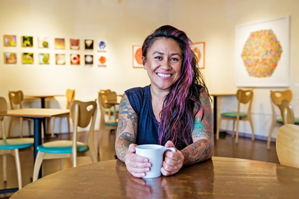 A FRESH SPACE, SAME FACES Longtime manager Kalae Neves and many of the baristas behind the counter have stayed on as Steynberg Gallery has transitioned to The 4 Cats Café and Gallery. - PHOTO BY JAYSOM MELLOM