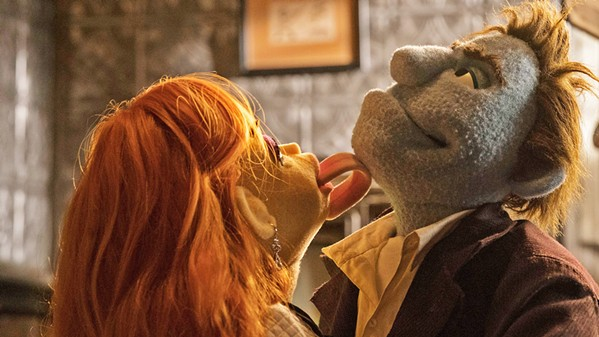 PUPPET SLEAZE Sandra White (voiced by Dorien Davies) butters-up private dick Phil Philips (voiced by Bill Barretta), in the lowbrow Muppet satire The Happytime Murders. - PHOTO COURTESY OF FOCUS FEATURES