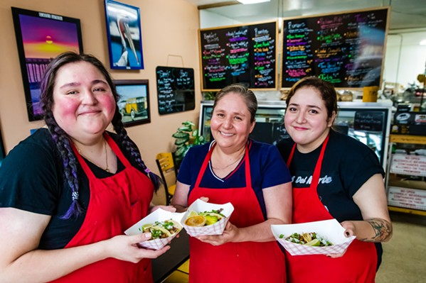 FAMILY RECIPES (From left to right) Viridiana, Matilde, and Jossi Bustos are the women behind the Cayucos Deli's homemade tacos. - PHOTO BY JAYSON MELLOM