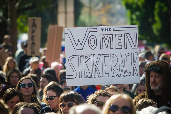 BACK IN THE STREETS A sign from the 2017 Women's March in SLO. On Sept. 26, the march's organizers held a rally in support of sexual assault victims, many of whom do not report their attacks. - FILE PHOTO BY JAYSON MELLOM