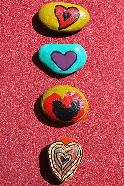 ROCKS OF EMPOWERMENT Therapeutic art is one way that Stand Strong tries to help victims of intimate partner violence—children and adults—sort through the trauma they've experienced. - PHOTO COURTESY OF STAND STRONG