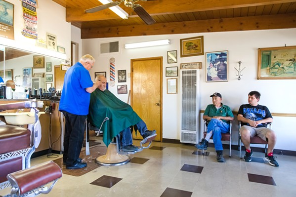 BUZZING CONVERSATION At 85 years old, Phillips is cutting hair and listening to the people of Atascadero who sit in his seat until 5 p.m. - PHOTO BY JAYSON MELLOM