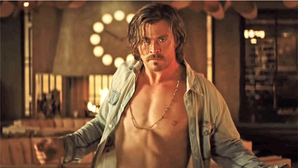 DARK CHARISMA Chris Hemsworth stars as Charles Manson-like cult leader Billy Lee, who rains down holy hell on the El Royale hotel. - PHOTOS COURTESY OF TWENTIETH CENTURY FOX