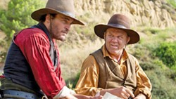 COMEDY ADVENTURE WESTERN? Charlie (Joaquin Phoenix, left) and Eli Sisters (John C. Reilly) are notorious assassins out to kill a gold prospector in 1850s Oregon, in The Sisters Brothers. - PHOTO COURTESY OF ANNAPURNA PICTURES