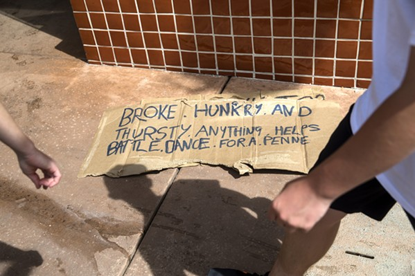 SIGN OF THE TIMES SLO's homeless population is a fixture of the city. Police say they try to reach out to offer help and services before citing and arrest homeless individuals. Still others worry that some of the city's laws penalize people because they are homeless. - PHOTO BY JAYSON MELLOM