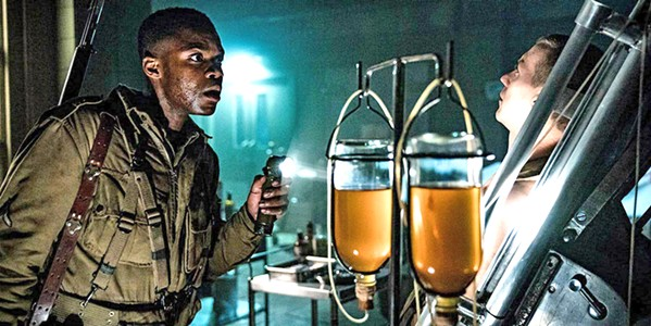 THE HORROR OF WAR Jovan Adepo stars as Boyce, a World War II-era paratrooper dropped behind enemy lines and right into a Nazi supernatural experiment, in the horror/mystery/action film Overlord. - PHOTO COURTESY OF BAD ROBOT