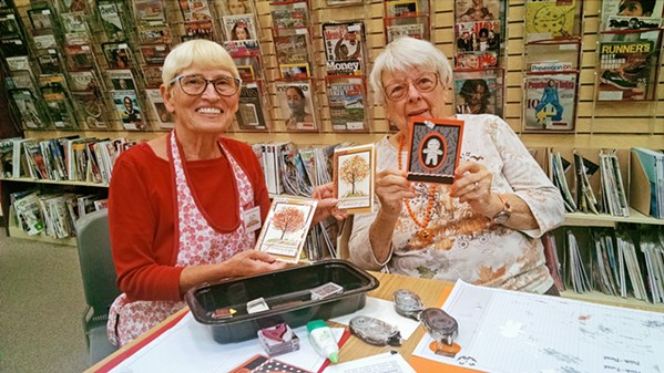 CARDCORE Instructor Suzy McBride (left) and workshop participant Snook Powers (right) show off their creations. - PHOTO BY CALEB WISEBLOOD