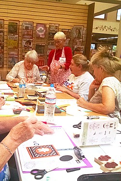 CLASS IN SESSION Stampin' Up demonstrator Suzy McBride hosts Stamp Camp workshops throughout the year at libraries, fundraising events, and her own home. - PHOTO BY CALEB WISEBLOOD