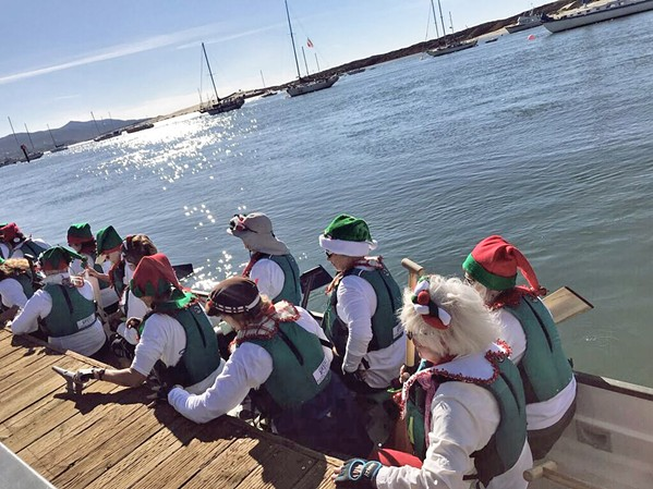 ELFING AROUND In addition to the evening grandeur of the Lighted Boat Parade, paddle boarders, kayakers, and surfers are welcome to a day parade. - PHOTO COURTESY OF TERI BAYUS