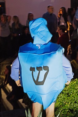 DREIDEL CHILD A child wears a dreidel costume at last year's Hanukkah Downtown at Mission SLO. - PHOTOS COURTESY OF THE JCC OF SLO