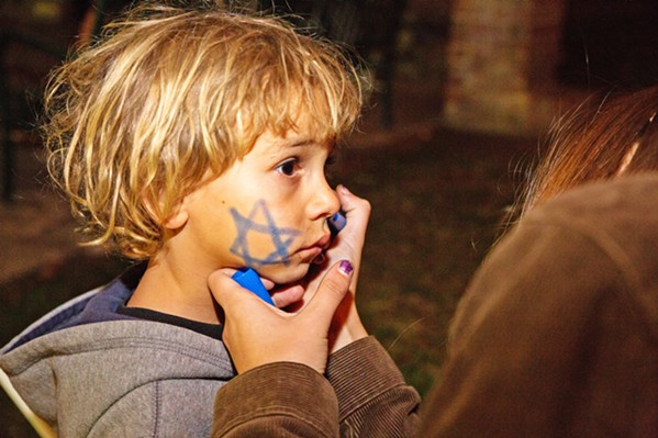 STAR A young child gets a Star of David drawn on his cheek on the first night of Hanukkah in 2017. - PHOTOS COURTESY OF THE JCC OF SLO